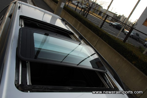 Twin glass electric sunroofs.