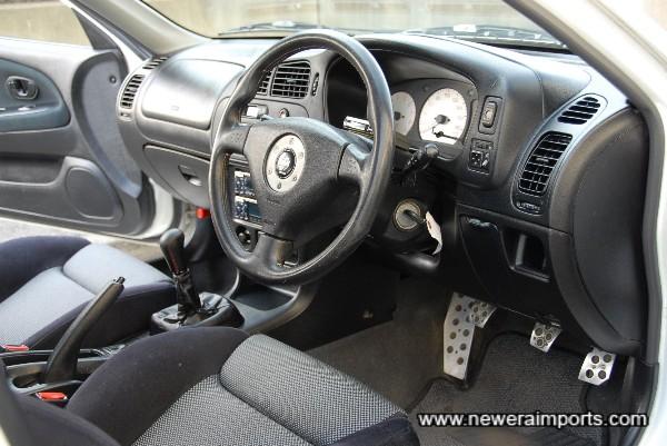 Steering wheel and instrumentation is unworn.