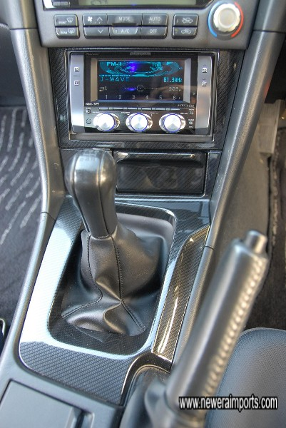 Carbon centre console. Carbon leather gear and handbrake gaiters are also available from www.neweraparts.com