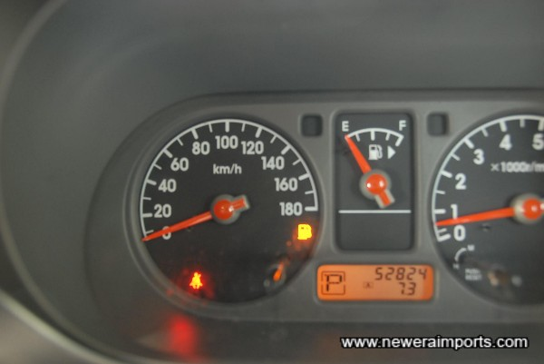 Odometer shows mileage in kilometres, before recalibration to show total in miles.