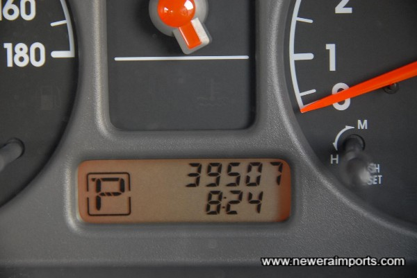 Original odometer mileage shown in km - before recalibration to miles in UK