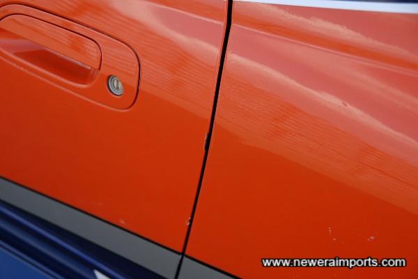 Passenger door edges scratched.