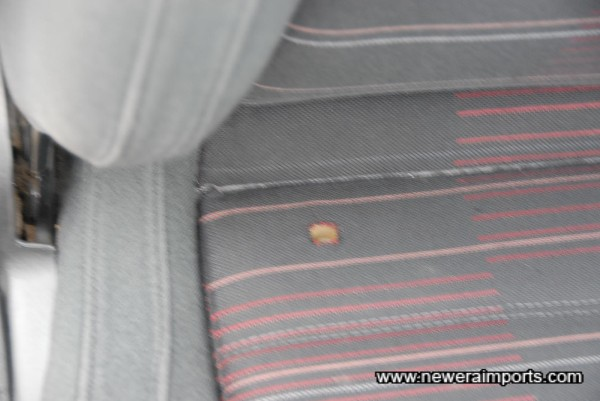 Small hole on driver's seat. Will be repaired as part of UK preparation.