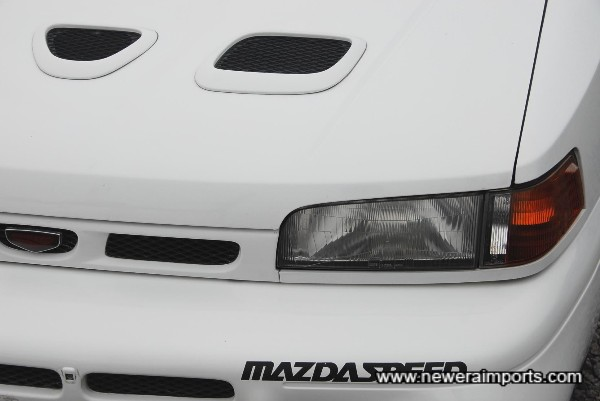 Headlights slightly faded. Polishing will bring these back.