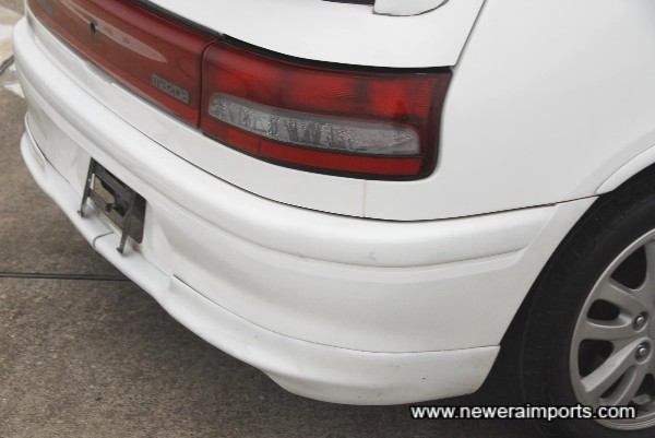 Rear bumper scratched - to be repainted as part of full UK OTR preparation package.