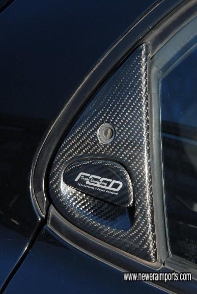 FEED Carbon door handle trims.