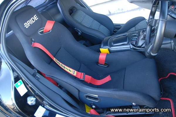 Bride adjustable bucket seat and Sabelt harnesses.