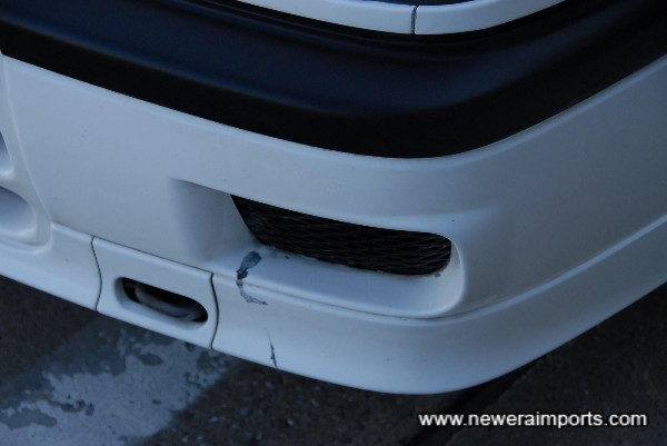 Minor scratches to the bottom corner of bumper - To be repaired as part of full UK OTR package.