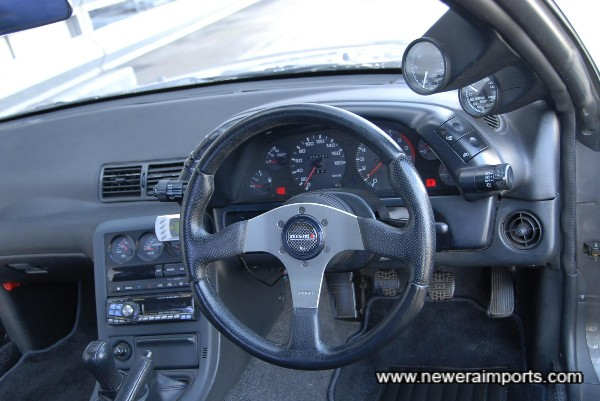 Momo steering wheel, with Nismo horn button.