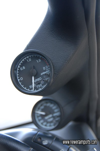 Greddy A pilar mounted electronic gauges for turbo and water temp.