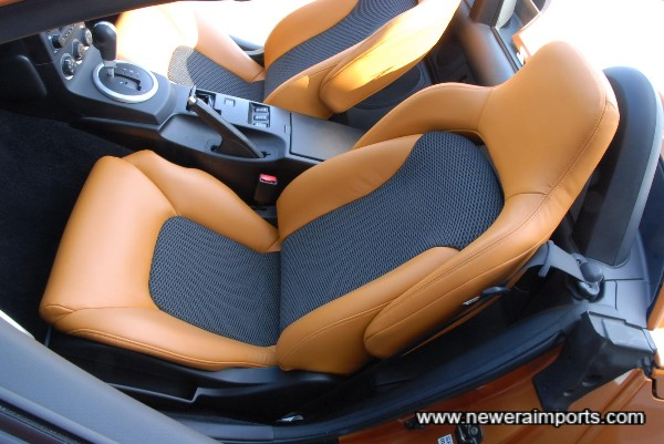 Leather seats with heating, electric adjustment and vented mesh on centre sections.