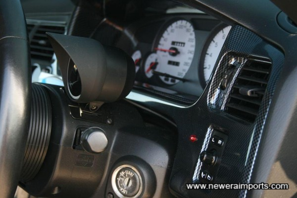 Carbon look dash surround - custom made as a one off for this car.