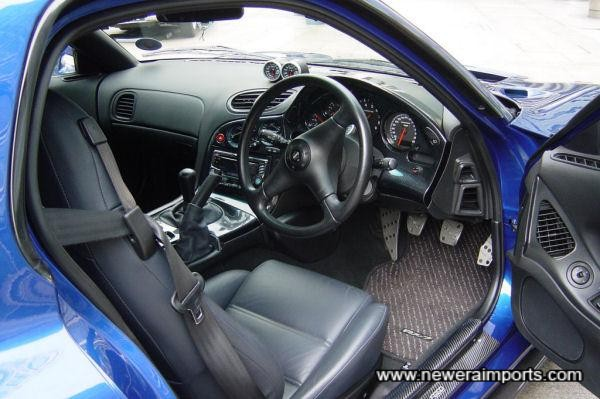 Seats and gaiters have been custom retrimmed in Navy Leather.