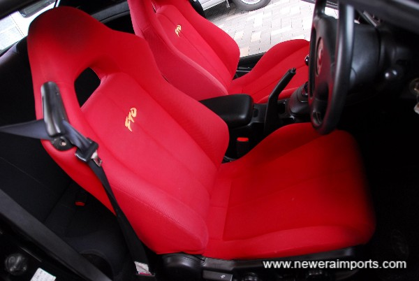 Bolsters and seat fabric aren't worn thin, as is usual on high mileage FTO's.