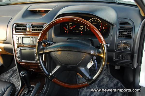 Nardi wood rim / leather steering wheel.