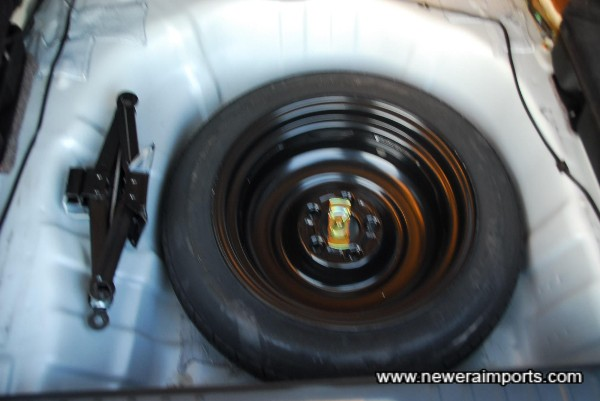Below the tray, sits the spare wheel & jack (Unused).