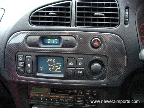 Carbon look climate control panel.