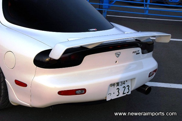 Mazdaspeed spoiler appears to fit on original 1996 - 1998 type rear spoiler mounting holes.