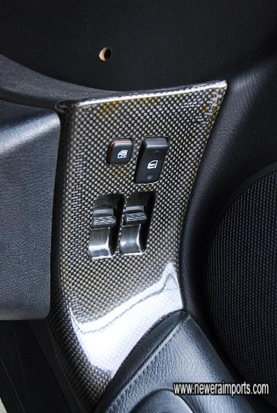 Carbon dash and door window switch panel.
