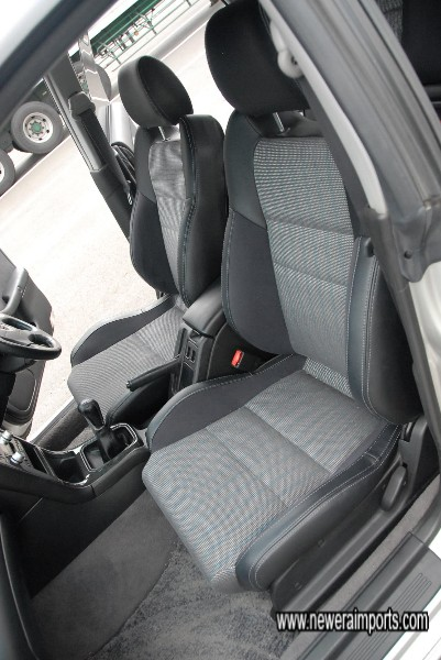 Half leather seats with Alcantara inserts.