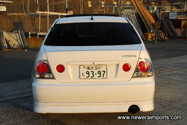 Factory fitted bodykit includes rear bumper spoiler.