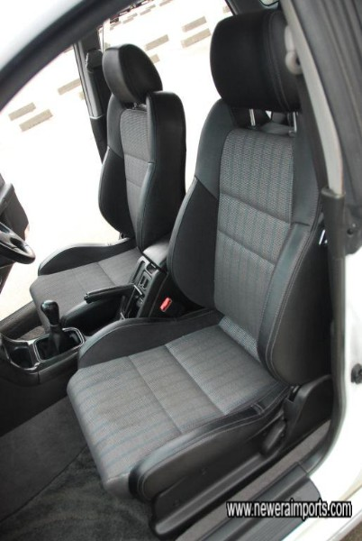 Half leather interior is as perfect as the exterior - clean and completely unmarked.