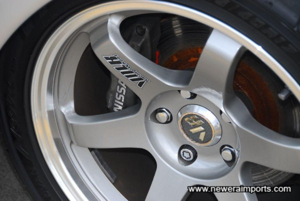 Nismo high performance brake pads are fitted to front.