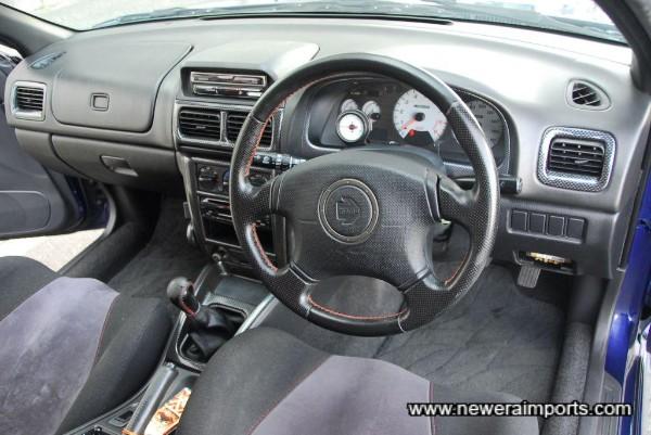 Steering wheel and switchgear is unworn.