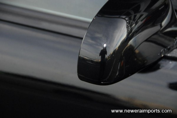 Minor scratch on the driver's door mirror - has been touched in by the previous owner. Scratch is too small to repair!