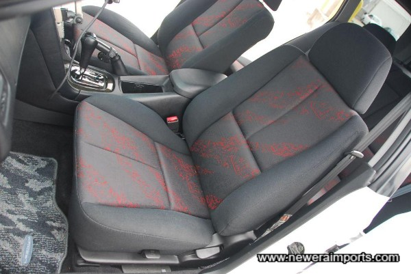 Facelift model has new seat design with more modern cloth upholstery.