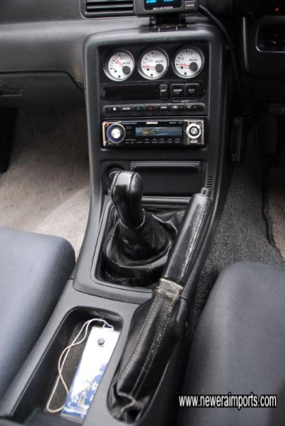 Gear shift and handbrake gaiters are in good condition in keeping with low mileage.