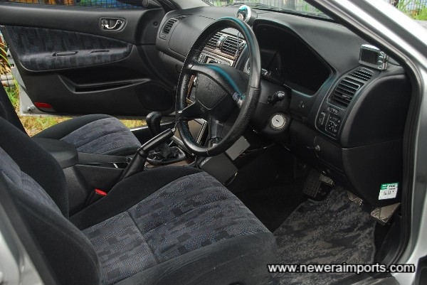 Interior shows lack of wear, in keeping with the car's genuine low mileage.