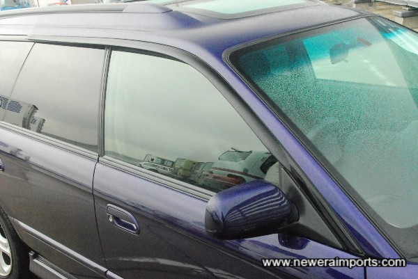 Factory fitted wind deflectors.