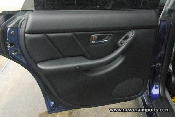 Note door inserts are leather trimmed, not cloth as on other models.