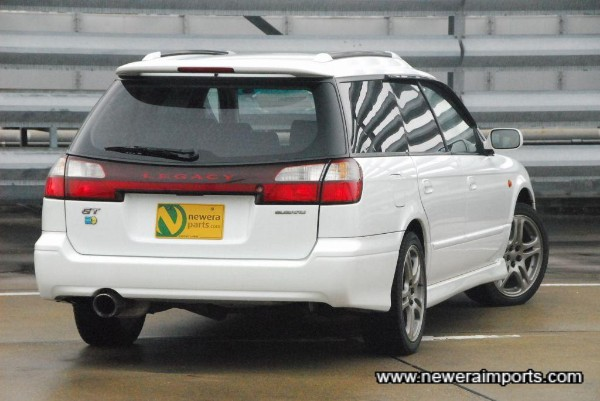 High level rear spoiler with integrated brake light.