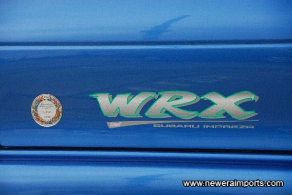 555 has commemorative badge in celebration of Subaru's No. 1 WRC victory in 1996,