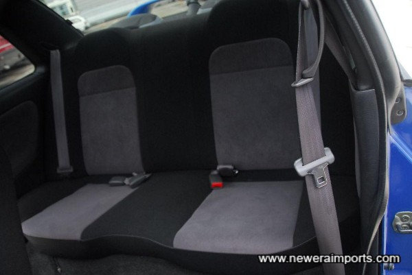Privacy glass for rear windows - rear seats are unused.