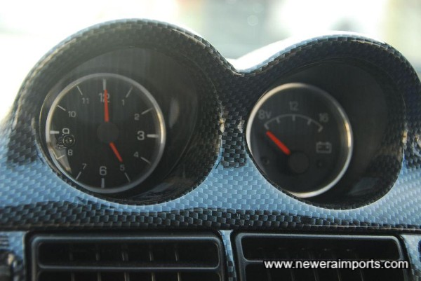 Note even the centre gauges have alloy bezels.