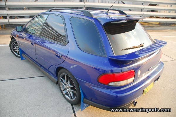STi model has larger rear spoilers than original Impreza WRX sports wagon.