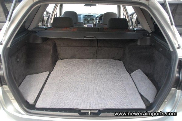 Rear has reversible fitted mats for protection.