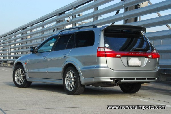 Note facelift rear bumper has a pseudo-diffuser at the bottom.