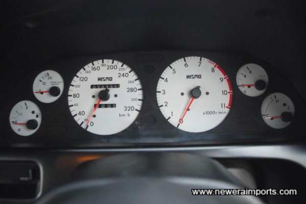 Nismo 320km/h Speedometer and accompanying gauge cluster.