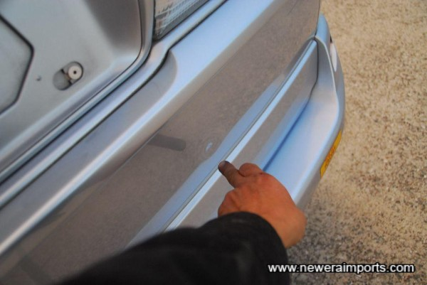 Small pin dent on rear door - too minor to repair, but mentioned to give a complete report.