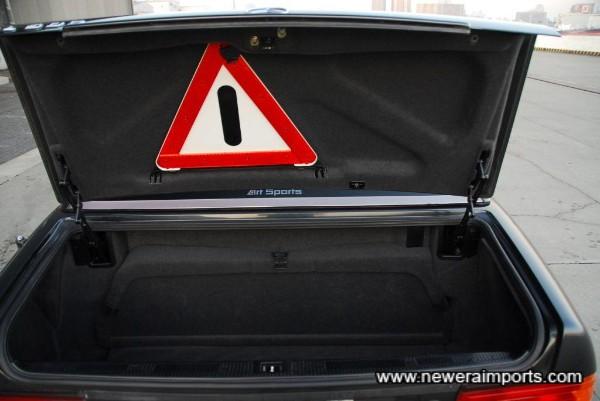 Boot trim has original warning triangle.