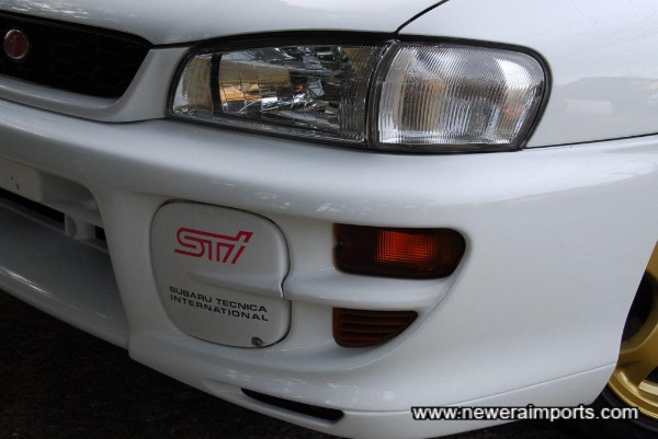 Sti 5 has facelift design of front bumper and headlights.