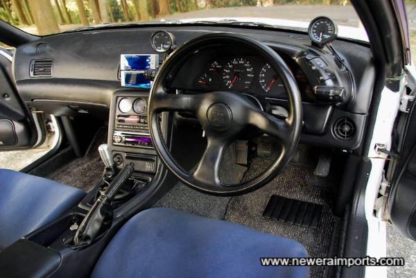 Original steering wheel is unworn.