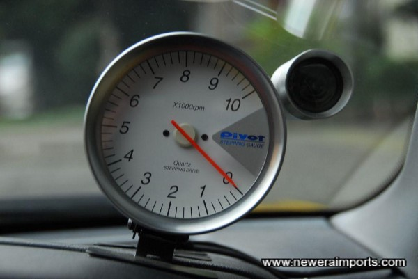 Pivot Rev counter with shift light.