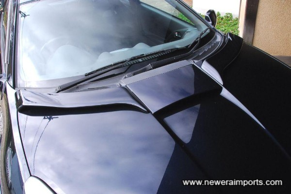 Bonnet spoiler helps make windscreen wipers more efficient in the rain.