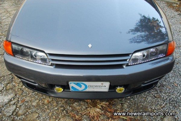 Headlights have LED markers. Can be returned to standard spec headlights at no additional cost (before shipment).