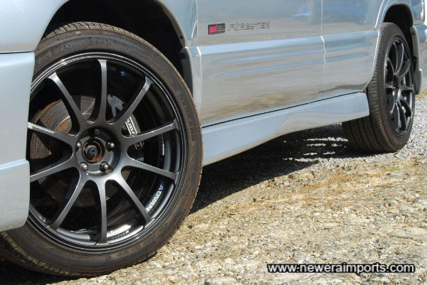 Sti 4-piston callipers and larger discs included as part of Sti II Type M package.